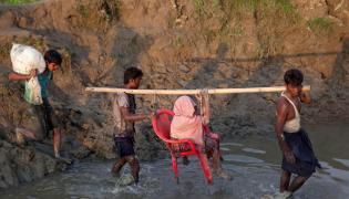 Uciekający Rohingya
