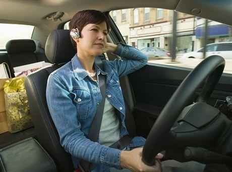 Businesswoman in Her Car --- Image by © Jim Craigmyle/Corbis