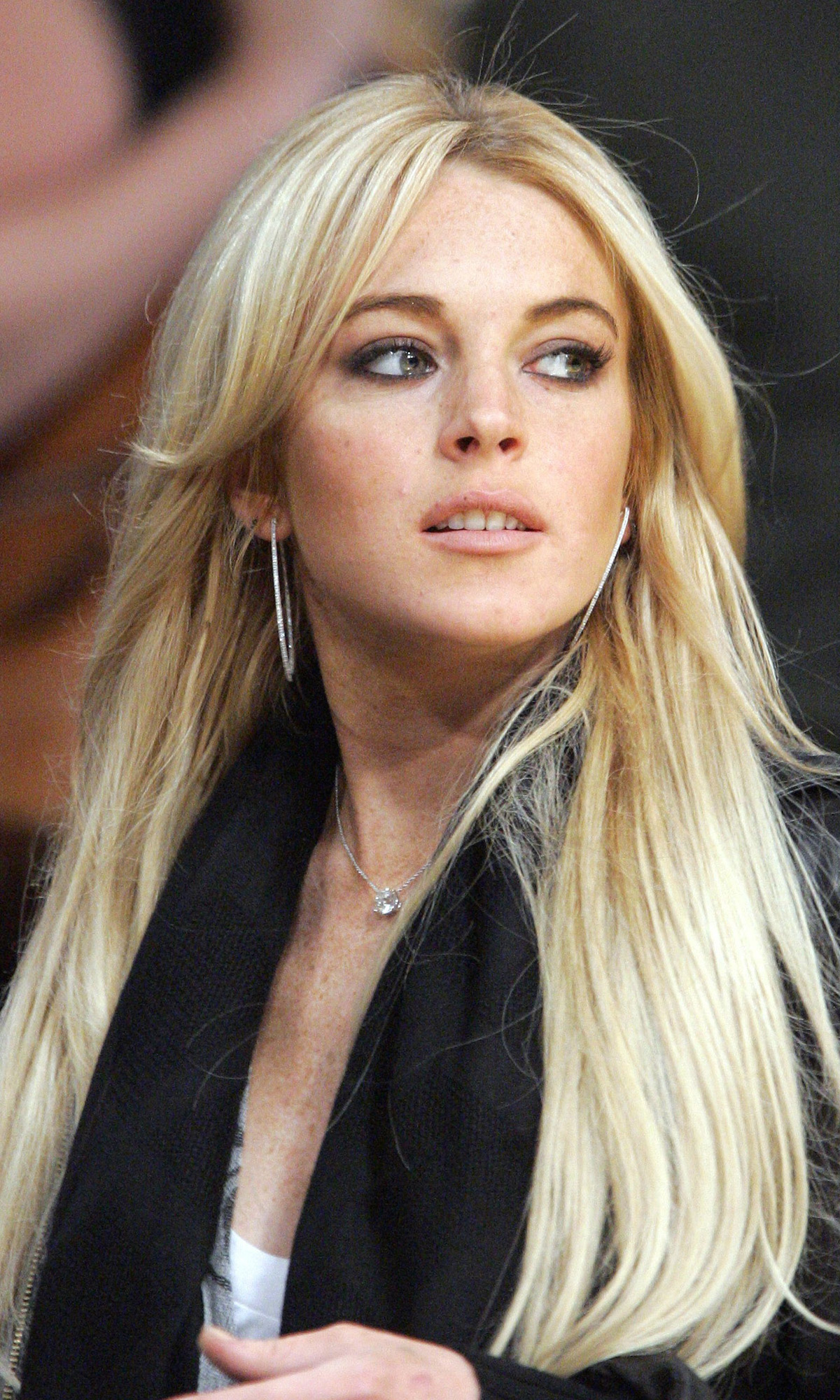 ** FILE ** Actress Lindsay Lohan is seen at the Los Angeles Lakers game against the Orlando Magic, in this Dec. 2, 2007, file photo in Los Angeles. Sales of Britney Spears-related eBay items topped those for Paris Hilton and Lindsay Lohan in 2007, according to the popular online auction site. There were 34,345 Spears-related items sold this year  while 27,377 items associated with Hilton were purchased. Lohan\'s name was only associated with 8,099 items sold. (AP Photo/Mark J. Terrill, file)