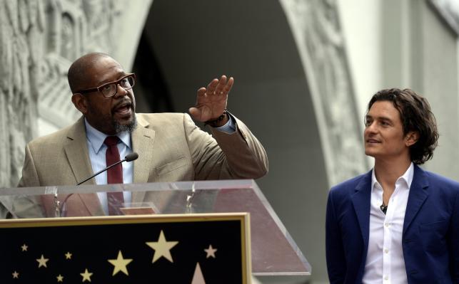 Orlando Bloom i Forest Whitaker podczas ceremonii w Alei Sław w Hollywood
